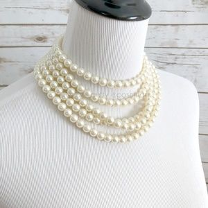 """The Crystal Skull"" 5 Strand Faux Pearl Necklace"